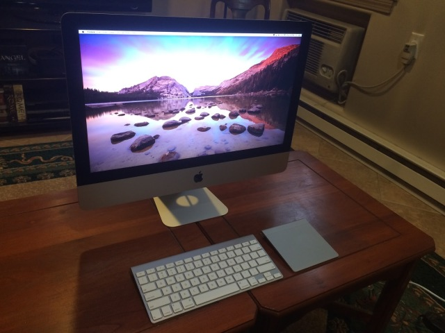 Photo of an iMac on a coffee table